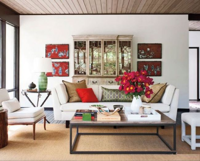 Mid Century Living Room With White Sofa And Red Accents