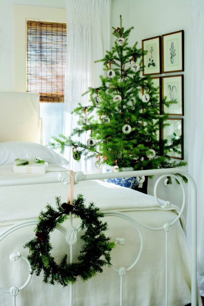 Simple Christmas Room Decor With Green Tree And Wreath As Focal Points