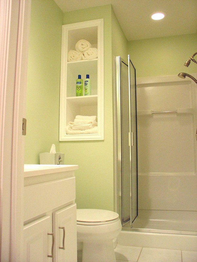 Pastel Green Walls Look Great In A Small Basement Bathroom.