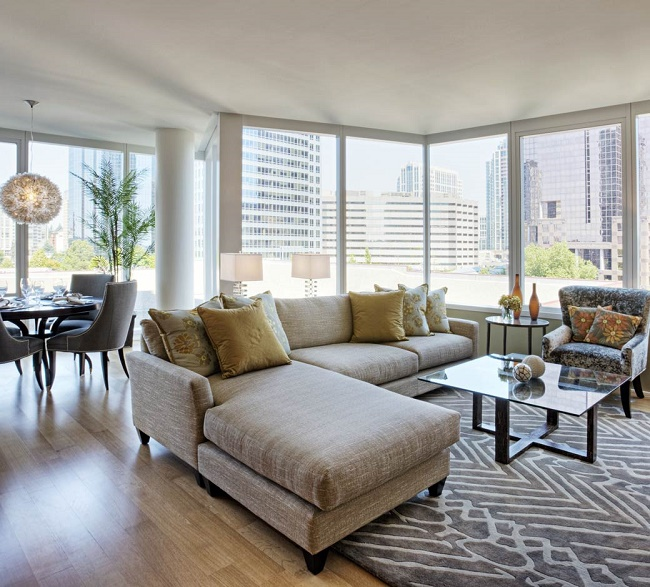 Spacious And Airy Living Room In A Modern Condo Unit.