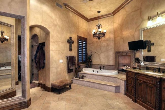 Mediterranean bathroom with iron and bronze accents