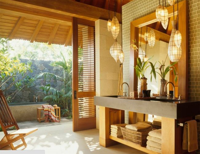 Wooden accented tropical master bathroom